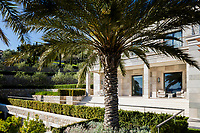 The impressive villa is a linear building incorporating a large loggia that overlooks the garden.