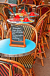 Outdoor cafe table and chairs in Paris, France