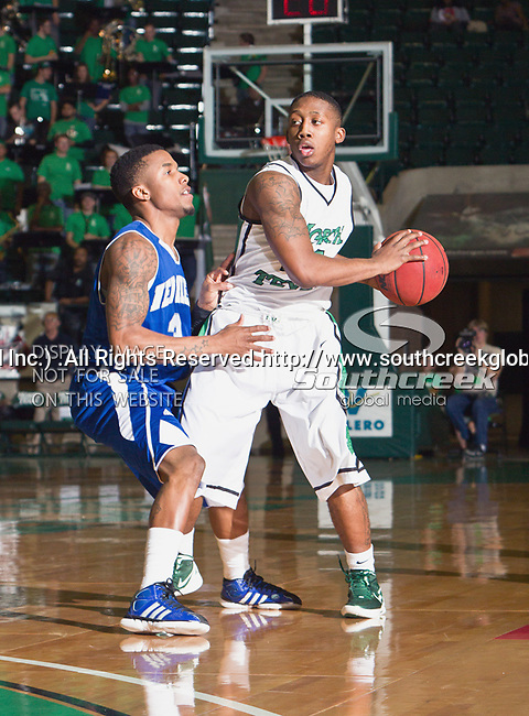 North Texas Mean Green guard Trey Norris (14) and New Orleans Privateers guard Rarlensee Nelson (3) in action during the game between the New Orleans Privateers and the University of North Texas Mean Green at the North Texas Coliseum,the Super Pit, in Denton, Texas. UNT defeated UNO 78 to 47.....
