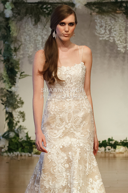 """Model walks runway in a bridal gown from the Sarah Jassir 2017 """"The Secret Garden"""" collection on October 8th 2016, during New York Bridal Fashion Week."""