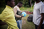 An African migrant looks at a world ball in Lakaxita. Irun (Basque Country). August 27, 2018. Lakaxita is a self-managed socio-cultural space located in an occupied house, where volunteers have created a hosting network for migrants in transit who have already completed the 5-day period that can remain in public resources. This group of volunteers is avoiding a serious humanitarian problem Irún, the Basque municipality on the border with Hendaye. As the number of migrants arriving on the coasts of southern Spain incresead, more and more migrants are heading north to the border city of Irun. (Gari Garaialde / Bostok Photo)