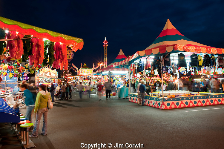 Evergreen State Fair at twilight game booths at night Monroe Washington State USA