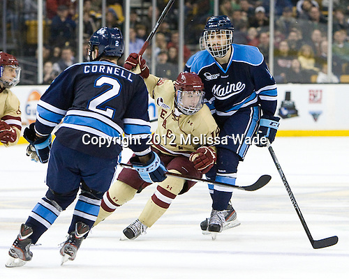 Michael Sit (BC - 18), John Parker (Maine - 15) - The Boston College Eagles defeated the University of Maine Black Bears 4-1 to win the 2012 Hockey East championship on Saturday, March 17, 2012, at TD Garden in Boston, Massachusetts.