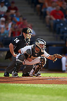 Umpire Randy Rosenberg and Akron RubberDucks catcher Jeremy Lucas (12) during a game against the Richmond Flying Squirrels on July 26, 2016 at Canal Park in Akron, Ohio .  Richmond defeated Akron 10-4.  (Mike Janes/Four Seam Images)