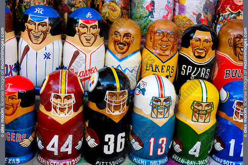Colorful set of decorative american sport players nesting dolls matreshkas standing in rows. Ukrainian souvenirs and crafts. Baseball football basketball players. Washington Redskins, Miami Dolphins, Pittsburgh, Texas, Green Bay Packers, Minnesota Vikings, New York Yankees, Lakers, Spurs, Bulls