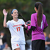 Sacred Heart No. 17 Ellen Burns, left, celebrates with goalie Sara Micheli after their team's 3-1 win over St. John the Baptist in a CHSAA varsity girls' soccer game at Sacred Heart Academy on Monday, October 5, 2015.<br /> <br /> James Escher