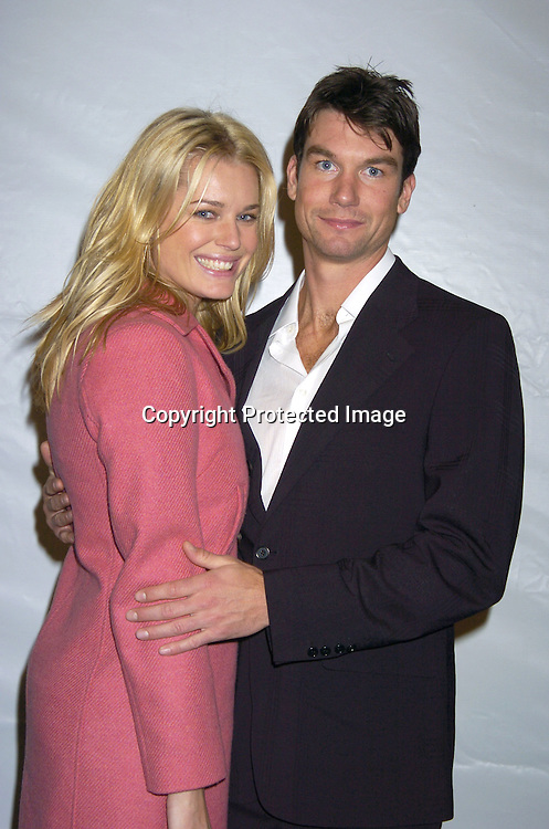 Rebecca Romijn and Jerry O'Connell  ..at The Perry Ellis Menswear Show on February 4, 2005 ..at Olympus Fashion Week in Bryant Park in New York City. ..Photo by Robin Platzer, Twin Images
