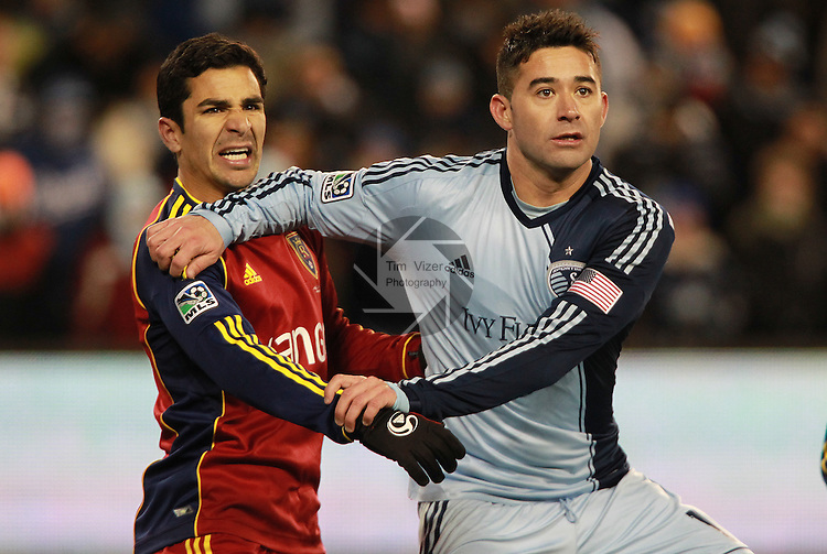 Real Salt Lake defender Tony Beltran (2, left) grapples with Sporting KC forward Claudio Bieler (16) for position on an incoming corner kick in the second half. Sporting KC defeated Real Salt Lake in a shootout after the score was tied 1-1 at the end of regulation play in the MLS Cup 2013 championship held at Sporting Park in Kansas City, Kansas on Saturday December 7, 2013.