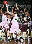 North Texas Mean Green forward Ash'Lynne Evans (1) and North Texas Mean Green guard Desiree Nelson (22) in action during the NCAA Women's basketball game between the University of Louisiana at Monroe Warhawks and the University of North Texas Mean Green at the North Texas Coliseum,the Super Pit, in Denton, Texas. ULM defeated UNT 50 to 47.