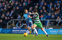 Paris Cowan-Hall of Wycombe Wanderers battles Liam Shephard of Yeovil Town during the Sky Bet League 2 match between Wycombe Wanderers and Yeovil Town at Adams Park, High Wycombe, England on 14 January 2017. Photo by Andy Rowland / PRiME Media Images.