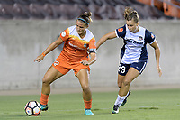 Houston, TX - Saturday July 15, 2017: Amber Brooks and Meggie Dougherty Howard battle for control of the ball during a regular season National Women's Soccer League (NWSL) match between the Houston Dash and the Washington Spirit at BBVA Compass Stadium.