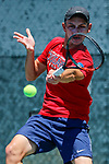 SURPRISE, AZ - MAY 12: Matei Avram of the Columbus State returns a ball against Daniel Ventura of the Barry Buccaneers during the Division II Men's Tennis Championship held at the Surprise Tennis & Racquet Club on May 12, 2018 in Surprise, Arizona. (Photo by Jack Dempsey/NCAA Photos via Getty Images)