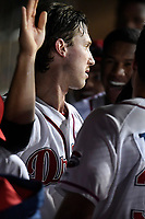 Right fielder Ryan Scott (30) of the Greenville Drive is greeted in the dunout after scoring a run in Game 4 of the South Atlantic League Championship Series against the Kannapolis Intimidators on Friday, September 15, 2017, at Fluor Field at the West End in Greenville, South Carolina. Greenville won 8-3 for the team's first SAL Championship, winning the series 3-1. (Tom Priddy/Four Seam Images)