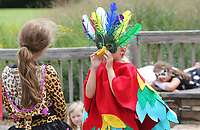 NWA Democrat-Gazette/DAVID GOTTSCHALK  Sophia Frank (right) acts Friday, July 14, 2017, with her group the Flying Golden Pineapples  as they perform a play at Gulley Park in Fayetteville.  The children were participating in the city of Fayetteville Parks and Recreation Department and Young Actors Guild one week Drama Camp which introduced the campers to acting and theater with fundamental techniques and methods. The camp ended Friday with five cheers and five plays by the participants.