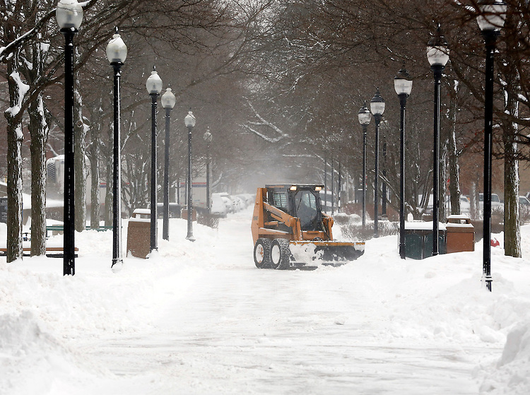 Crews plow through snow on the quad of DePaul University's Lincoln Park campus in Chicago as the New Year brought two days of lake effect snow and ice. (Photo by Jamie Moncrief)