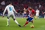 Atletico de Madrid Yannick Carrasco and Real Madrid Raphael Varane during La Liga match between Atletico de Madrid and Real Madrid at Wanda Metropolitano in Madrid, Spain. November 18, 2017. (ALTERPHOTOS/Borja B.Hojas)