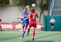 Seattle, WA - Saturday Aug. 27, 2016: Beverly Yanez, Katherine Reynolds during a regular season National Women's Soccer League (NWSL) match between the Seattle Reign FC and the Portland Thorns FC at Memorial Stadium.