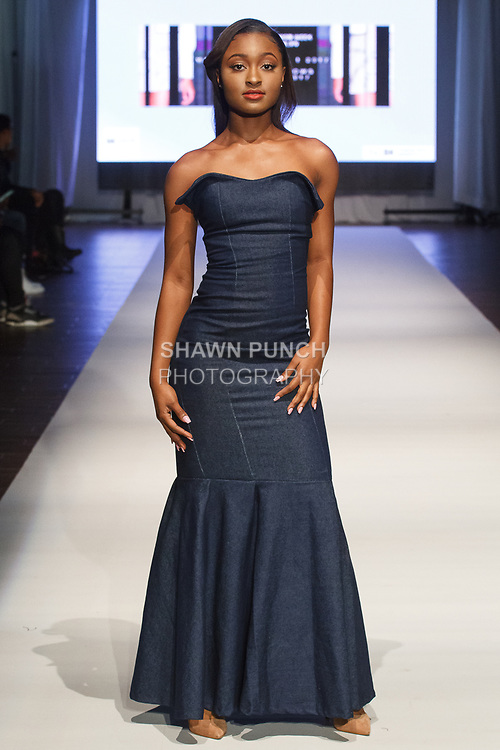 Model walks runway in an outfit from the Maxwell High School Fall Winter 2017 collection fashion show, at the Brooklyn EXPO Center on March 31, 2017 during Fashion Week Brooklyn Fall Winter 2017.