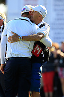 European Team Player Nicolas Colsaerts (BEL) gets a hug from his father after conceding the match to USA's Dustin Johnson on the 16th green during Sunday's Singles Matches of the 39th Ryder Cup at Medinah Country Club, Chicago, Illinois 30th September 2012 (Photo Colum Watts/www.golffile.ie)