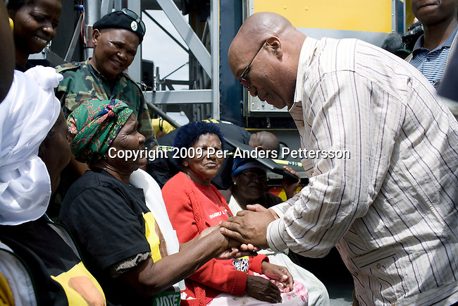 CAPE TOWN, SOUTH AFRICA FEBRUARY 21: ANC president Jacob Zuma (r) greets pensioners at a rally on February 21, 2009 in Delft a poor township outside Cape Town, South Africa. Mr. Zuma went for a door-to-door campaign to drum up support for his party ahead of the elections. Mr. Zuma was recently cleared of several fraud and corruption charges and he is expected to win the general election on April 22, and become South Africa's third democratic elected president. (Photo by Per-Anders Pettersson)..