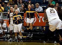 California's Justine Hartman, Mikayla Lyles and Avigiel Cohen celebrate from the bench after Gennifer Brandon made a huge play during the game against Kansas at Haas Pavilion in Berkeley, California on December 21st, 2012.  California defeated Kansas, 88-79.