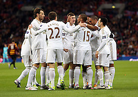 Pictured: Nathan Dyer of Swansea is celebrating his goal mobbed by team mates. Sunday 24 February 2013<br />