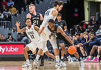 WASHINGTON, DC - JANUARY 28: Kamar Baldwin #3 of Butler moves past Omer Yurtseven #44 of Georgetown during a game between Butler and Georgetown at Capital One Arena on January 28, 2020 in Washington, DC.