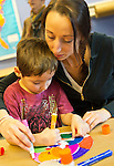 Garden City, New York, U.S. January 20, 2014. L-R, AIDAN TROPEANO, 6, and his mother DEANNA TROPEANO, 30, of Levittown, create artwork of peace at the program Dreaming with Dr. Martin Luther King, Jr. where children also explored Dr. King's life, at the Long Island Children's Museum, to celebrate the American official federal holiday Birthday of Martin Luther King, Jr.