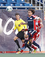 New England Revolution defender Kevin Alston (30) working hard late in the match..  In a Major League Soccer (MLS) match, FC Dallas (red) defeated the New England Revolution (blue), 1-0, at Gillette Stadium on March 30, 2013.