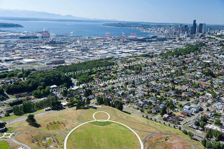 aerial photo of downtown Seattle skyline and Elliott Bay views from Seattle's Jefferson Park, former site of two urban reservoirs on Seattle's Beacon Hill; while the larger was buried underground and lidded, the smaller of the two is now drained, filled, and topped with playfields making one of the greatest views in the city accessible to all; Seattle, WA; July, 2011