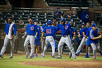 AZL Cubs shortstop Delvin Zinn (not pictured) is congratulated by Alfredo Colorado (75), Luis Vazquez (1), and Jonathan Sierra (22) after scoring a run against the AZL Giants on September 5, 2017 at Scottsdale Stadium in Scottsdale, Arizona. AZL Cubs defeated the AZL Giants 10-4 to take a 1-0 lead in the Arizona League Championship Series. (Zachary Lucy/Four Seam Images)