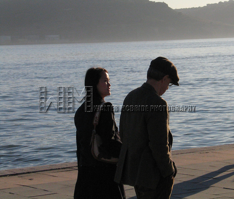 *** EXCLUSIVE Coverage ***.Woody Allen and Soon-Yi Previn walking along the Tagus River in Lisbon, Portugal..December 31, 2004.© Walter McBride /