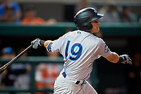 Tampa Tarpons shortstop Diego Castillo (19) follows through on a swing during a game against the Lakeland Flying Tigers on April 5, 2018 at Publix Field at Joker Marchant Stadium in Lakeland, Florida.  Tampa defeated Lakeland 4-2.  (Mike Janes/Four Seam Images)