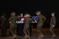 Members of the Official Party, including acting United States Secretary of Defense Patrick M. Shanahan, pay their respects as a US Marine Corps carry team participates in the Dignified Transfer of the transfer case containing the remains of United States Marine Corps Staff Sergeant Christopher A. Slutman at Dover Air Force Base in Dover, Delaware on April 11, 2019.  he died as the result of a road-side bomb in Afghanistan on April 8, 2019.  Staff Sergeant Slutman, a decorated 15 year veteran of the Fire Department of New York (FDNY), was married and had three children. Photo Credit: Ron Sachs/CNP/AdMedia