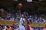 21 December 2007: Duke's Chante Black (11) makes a lay-up basket over Bucknell's Hope Foster (21). The Duke University Blue Devils defeated the Bucknell University Bisons 92-49 at Cameron Indoor Stadium in Durham, North Carolina in an NCAA Division I Women's College Basketball game.