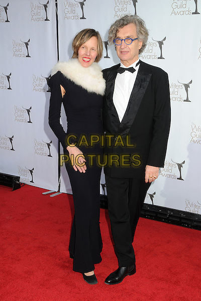 Donata & Wim Wenders.2012 Writers Guild Awards held at the Hollywood Palladium, Hollywood, California, USA..February 19th, 2012.full length black white tuxedo dress fur collar glasses married husband wife  .CAP/ADM/BP.©Byron Purvis/AdMedia/Capital Pictures.