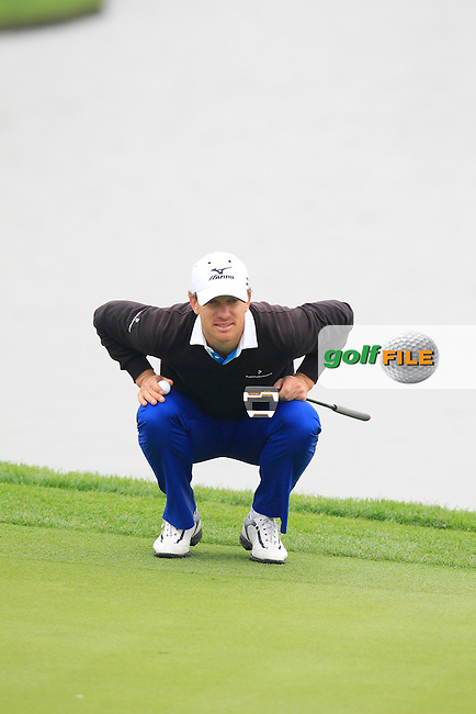 Magnus A.Carlsson (SWE) on the 13th green during Sunday's Final Round of the 2014 BMW Masters held at Lake Malaren, Shanghai, China. 2nd November 2014.<br /> Picture: Eoin Clarke www.golffile.ie