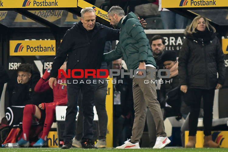 01.12.2019, Borussia-Park - Stadion, Moenchengladbach, GER, DFL, 1. BL, Borussia Moenchengladbach vs. SC Freiburg, DFL regulations prohibit any use of photographs as image sequences and/or quasi-video<br /> <br /> im Bild Christian Streich (SC Freiburg) gratuliert Marco Rose (Borussia Moenchengladbach) zum Sieg<br /> <br /> Foto © nordphoto/Mauelshagen