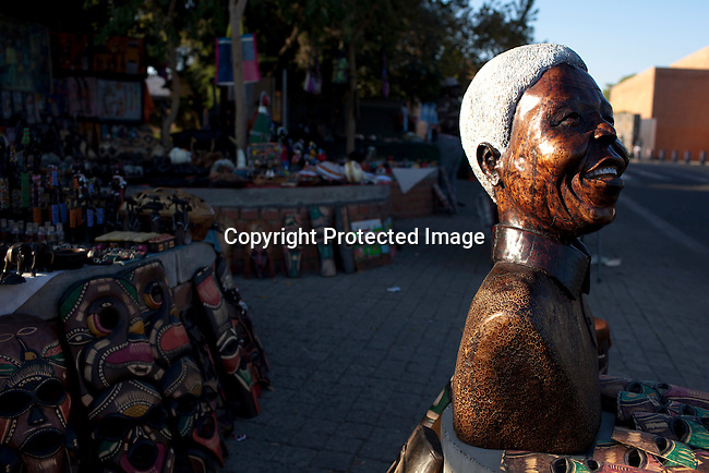 SOWETO, SOUTH AFRICA :) A Nelson Mandela statue and African souvenirs are sold next to Hector Pieterson museum in Soweto, South Africa. (Photo by Per-Anders Pettersson)