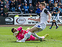 Dundee keeper Kyle Letheren saves at the feet of Caley's Marley Watkins.