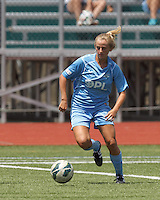 North Reading, Massachusetts - June 21, 2014:  In a Women's Premier Soccer League (WPSL) match, Boston Aztec (white/black) defeated Seacoast United Phantoms (blue), 2-1, at North Reading High School Stadium on Arthur J. Kenney Athletic Field.