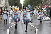 London, England. 31 August 2015. Performers from the London School of Samba. Performers and revellers were in good spirits despite a second years of heavy rain on the Adult Day of Notting Hill Carnival. Photo: Bettina Strenske