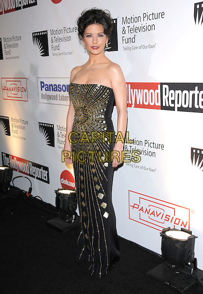 "CATHERINE ZETA JONES .at The 4th Annual ""A Fine Romance"" held at Sony Picture Studios in Culver City, California, USA,  November 08 2008.                                                                     .full length strapless black gold print dress ring hair up long maxi .CAP/DVS.©Debbie VanStory/Capital Pictures"