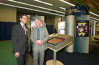 March 20 2003, Montreal, Quebec, Canada<br /> <br />  Andre Caille, President and CEO, Hydro Quebec (Quebec Provincial provider of Electricity) (R) explain to Andre Boisclair , Quebec Environment Minister (L); <br />  the technology used in it's Electric Car presented at Americana, a 3 days <br /> conference &amp; trade show on environement and waste management organized by Reseau Environnement, March 19, 2003 in Montreal, Canada.<br /> <br /> Electric cars fits into Quebec and Canada's pledge to conform to Kyoto Protocol by reducing pollution.<br /> <br /> Mandatory Credit: Photo by Pierre Roussel- Images Distribution. (&copy;) Copyright 2003 by Pierre Roussel <br /> <br /> NOTE : <br />  Nikon D-1 jpeg opened with Qimage icc profile, saved in Adobe 1998 RGB<br /> .Uncompressed  Original  size  file availble on request.