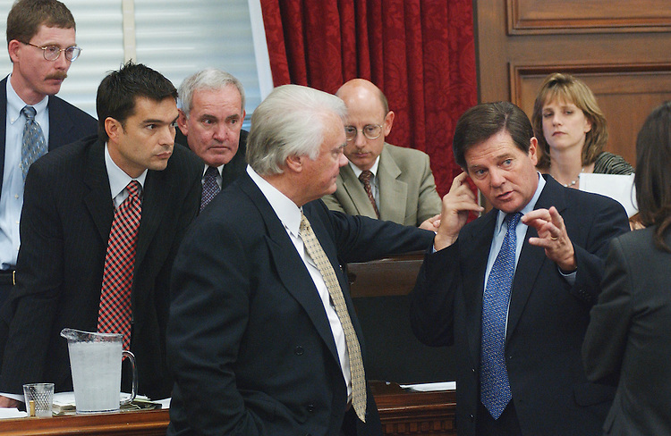5/9/02.SUPPLEMENTAL APPROPRIATIONS--Staff listens to a conversation between House Appropriations Chairman C.W. Bill Young, R-Fla., and Tom DeLay, R-Texas, during a break in the markup of the Supplemental Appropriations Bill for FY 2002..CONGRESSIONAL QUARTERLY PHOTO BY SCOTT J. FERRELL