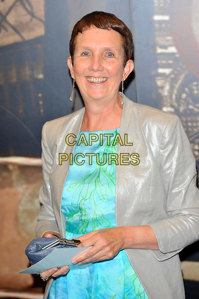 Ann Cleeves.Attending the Specsavers Crime Thriller Awards 2012, Grovsenor House Hotel. Park Lane, London, England, UK, .18th October 2012..half length green dress silver gold jacket .CAP/CJ.©Chris Joseph/Capital Pictures.