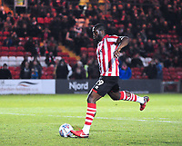 Lincoln City's John Akinde scores from the penalty spot<br /> <br /> Photographer Andrew Vaughan/CameraSport<br /> <br /> The EFL Checkatrade Trophy Northern Group H - Lincoln City v Wolverhampton Wanderers U21 - Tuesday 6th November 2018 - Sincil Bank - Lincoln<br />  <br /> World Copyright © 2018 CameraSport. All rights reserved. 43 Linden Ave. Countesthorpe. Leicester. England. LE8 5PG - Tel: +44 (0) 116 277 4147 - admin@camerasport.com - www.camerasport.com