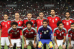 Egyptian players and Nigerian players compete during their African Cup of Nations group G qualification football match between Egypt and Nigeria at the Borg el-Arab Stadium in Alexandria on March 29, 2016. Photo by Stringer