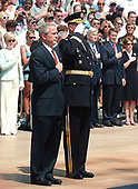 Washington, D.C. - May 29, 2006 -- United States President George W. Bush and Commandant of the Military District of Washington (MDW) Major General Guy C. Swann III show their respects for the fallen during a wreath laying ceremony at the Tomb of the Unknowns at Arlington National Cemetery in Arlington, Virginia  by the on May 29, 2006.  The President and first lady were at Arlington for the annual Memorial Day Commemoration honoring fallen American heroes.<br /> Credit: Ron Sachs  - Pool via CNP