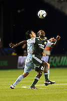 Diego Chara (21) midfielder Portland Timbers watches the ball despite the challenge from Roger Espinoza Sporting KC... Sporting Kansas City defeated Portland Timbers 3-1 at LIVESTRONG Sporting Park, Kansas City, Kansas.